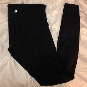 black LULULEMON winder under low-rise leggings